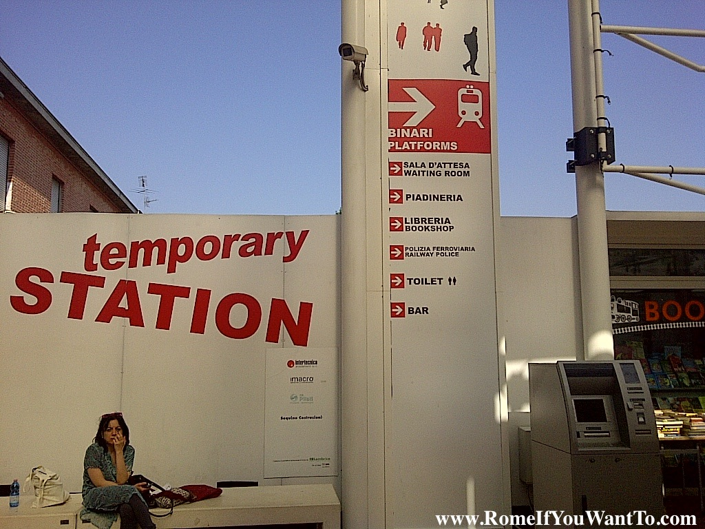 Temporary  Station? Why is this in English and what does it even mean exactly? Bonus points for the sign on the right, helpfully bilingual except for, randomly, ____, which was apparently too overwhelming to translate.