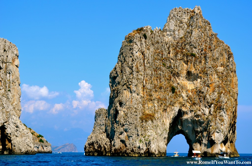 The famous Faraglioni rock formations, rising out of the sea, as high as a football field.