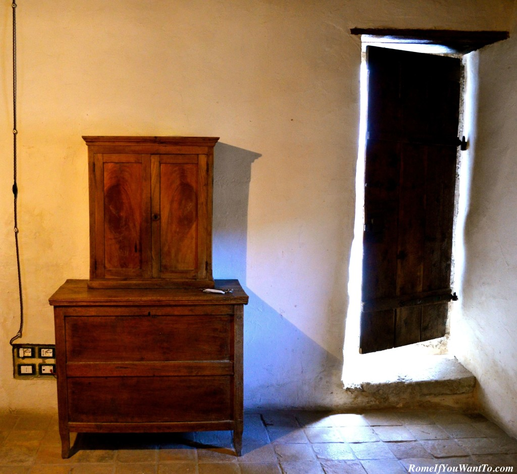 The entrance to my three-room suite is that old wooden door on the right.