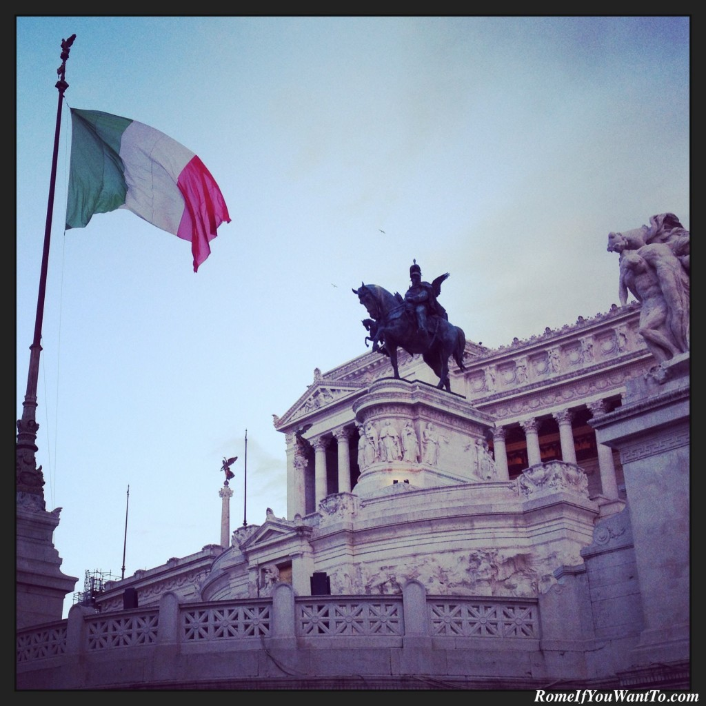 Italians hate this monument. I like it. And I thought the flag looked beautiful against the sky at dusk. Piazza Venezia.